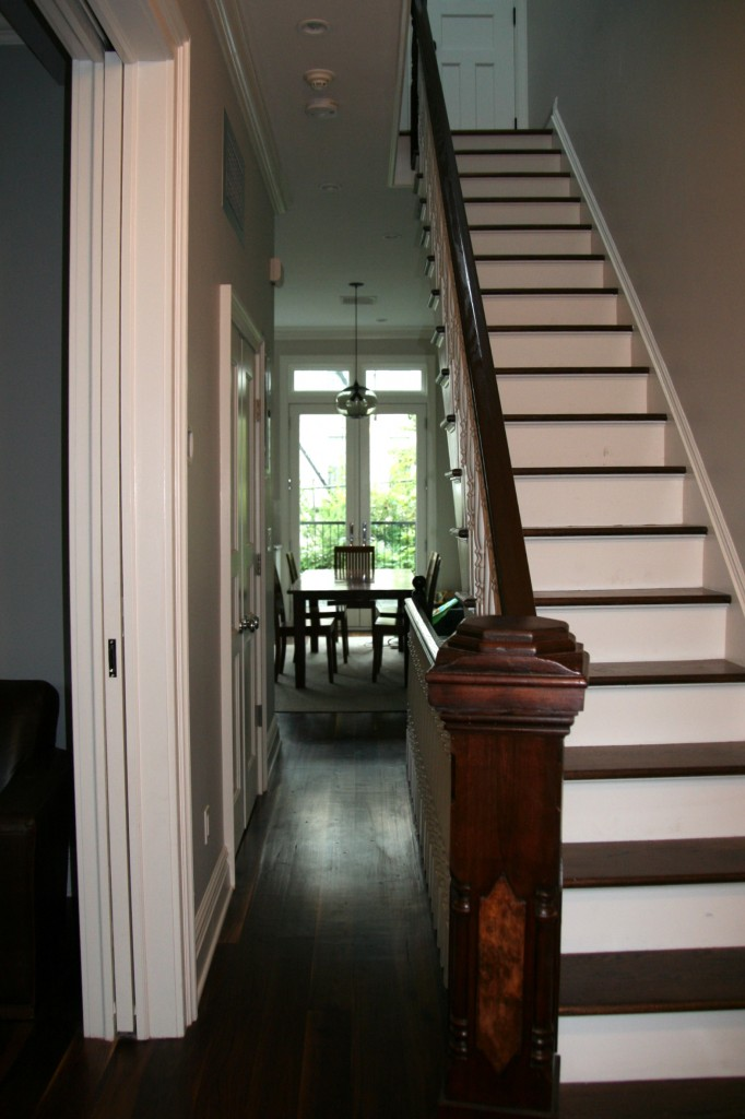 View to the dining area from the entry point of the house. Niche modern light fixture, Anderson doors to the deck.