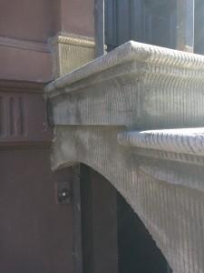 Header above the gate after scratch restoration.